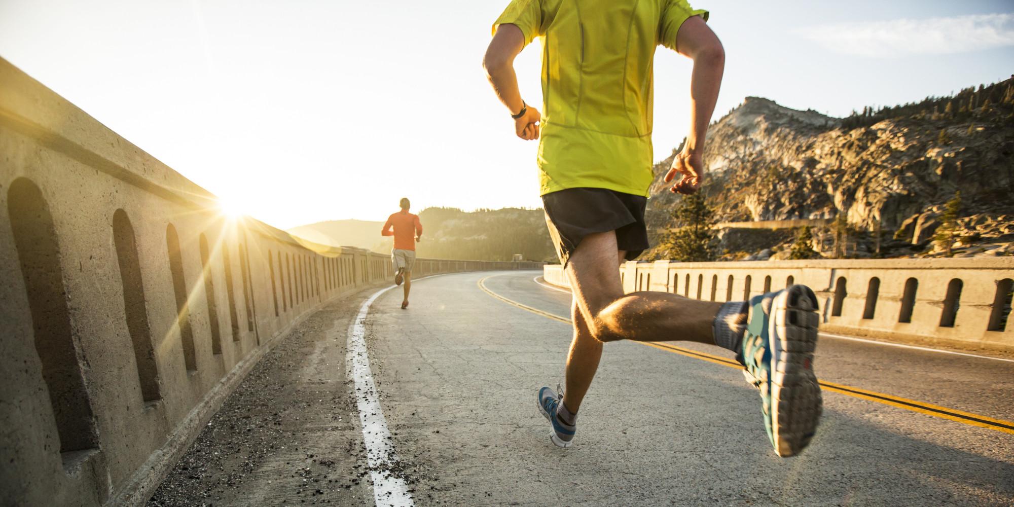 men running on road