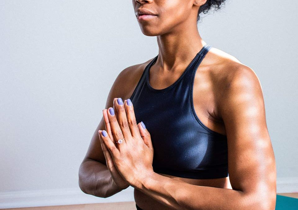 Woman doing yoga to stop feeling tired